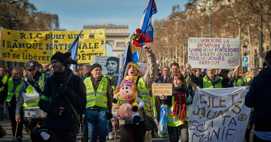 Gilets Jaunes or 'Yellow Vest' protesters march down the Champs Elysees during the second day of protests to mark the three-month anniversary of the movement on Saturday in Paris, France. Until now, the movement, which started as a protest against a rise in Fuel tax and a general rise in living costs implemented by President Macron and his government, has been largely supported by public opinion, but in a poll published this week, the majority of French people now think that the movement should stop.