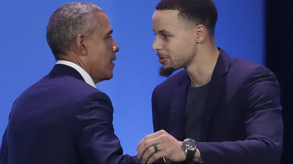 Former President Barack Obama, left, hugs Golden State Warriors basketball player Stephen Curry after speaking at the My Brother's Keeper Alliance Summit in Oakland, California, on Tuesday.