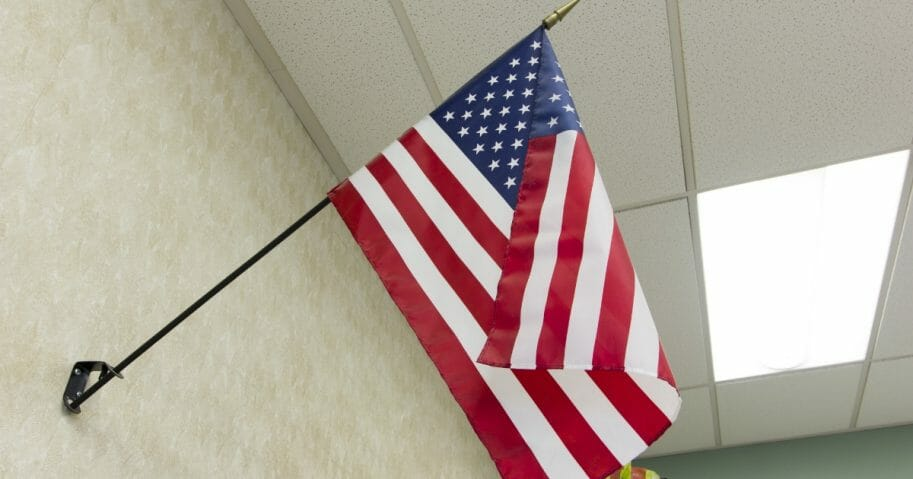 American flag hanging in a classroom.