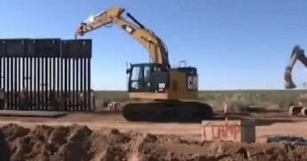 A still shot from a video posted to Twitter by President Donald Trump shows construction of a border wall on the U.S.-Mexico border in New Mexico. (