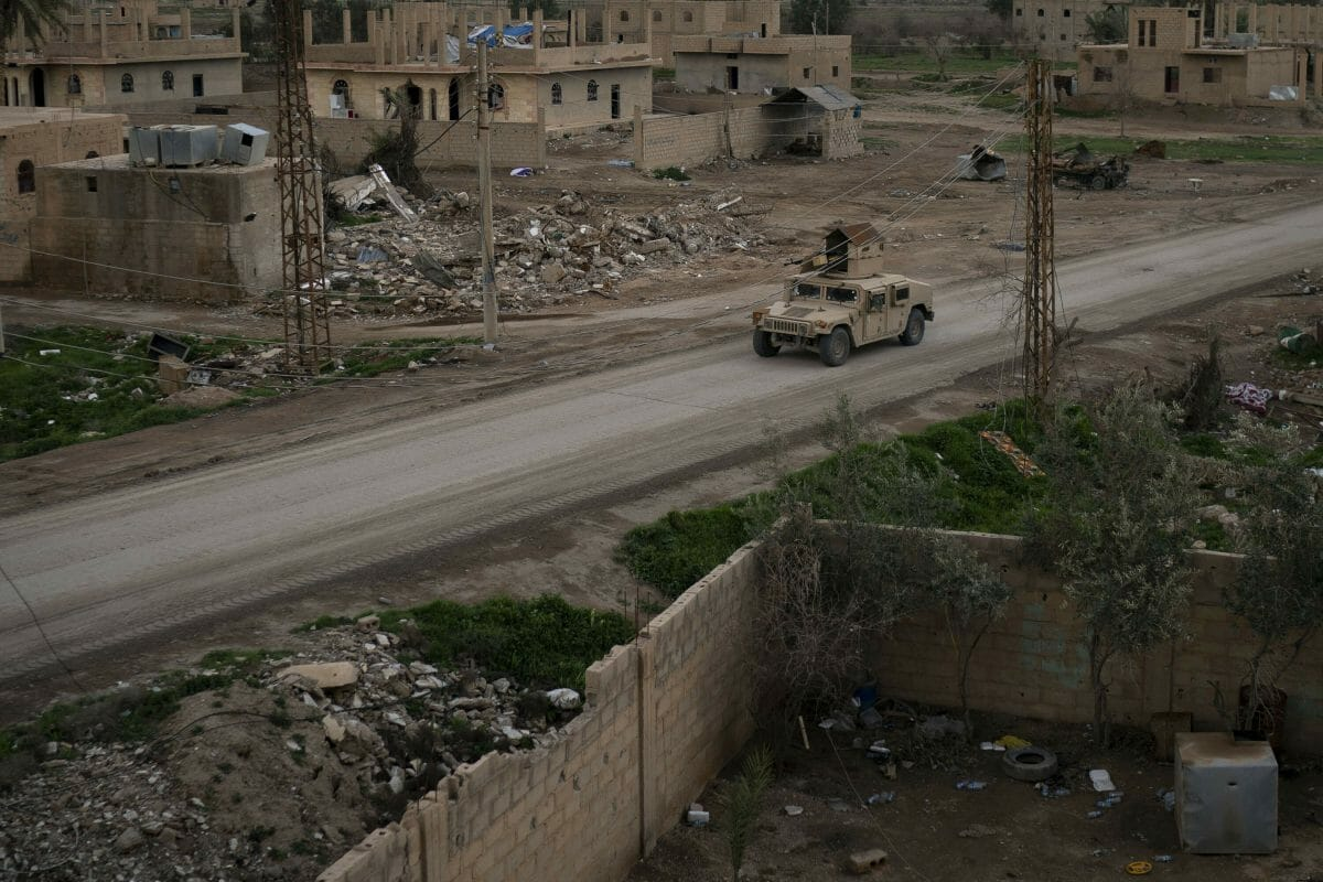 A Humvee drives in a village recently retaken from Islamic State militants by U.S.-backed Syrian Democratic Forces near Baghouz, Syria, Sunday, Feb. 17, 2019.