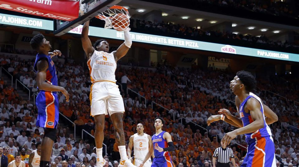 Tennessee guard Admiral Schofield (5) dunks the ball in front of Florida center Kevarrius Hayes (13) during the second half of an NCAA college basketball game on Saturday in Knoxville, Tennessee. The Volunteers won 73-61.