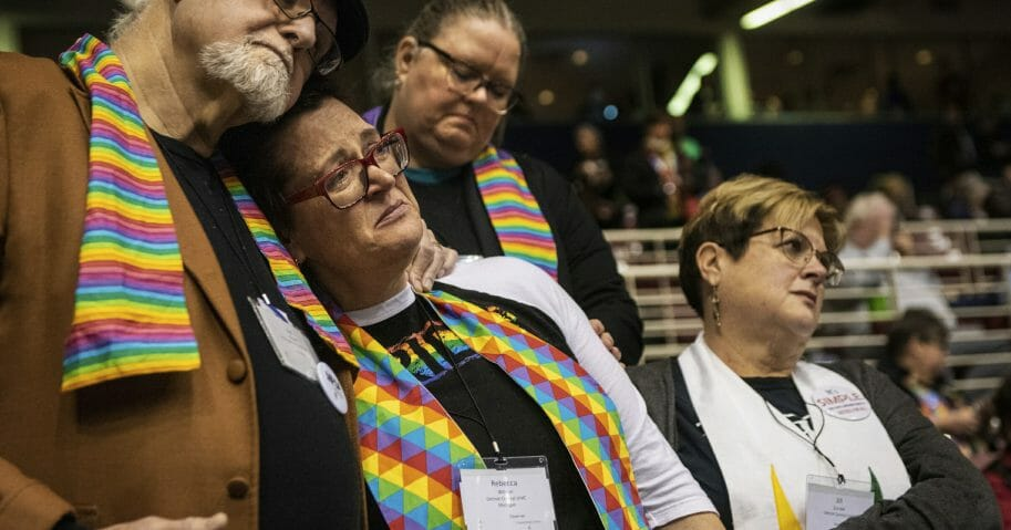 From left, Ed Rowe, Rebecca Wilson, Robin Hager and Jill Zundel, react to the defeat of a proposal that would allow LGBT clergy and same-sex marriage within the United Methodist Church at the denomination's 2019 Special Session of the General Conference in St. Louis on Tuesday.