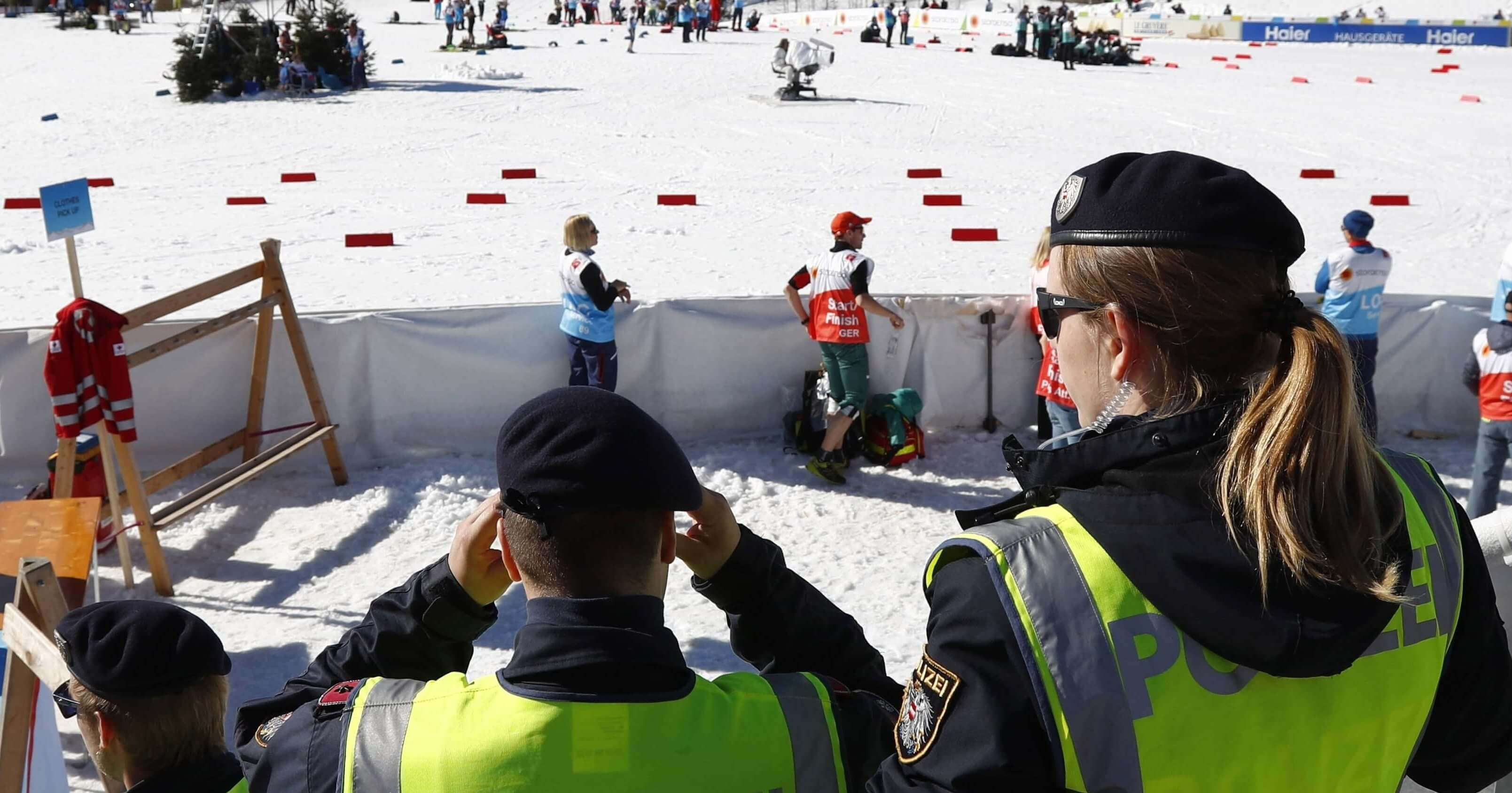 Austrian police officers stand at the finish area of a men's cross country skiing 15km classic competition at the Nordic Ski World Championships in Seefeld, Austria, on Wednesday.