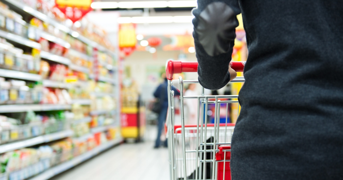 Close-up of woman with shopping cart.