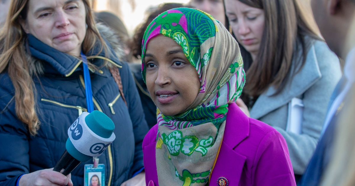 Rep Ilhan Omar speaks to media.
