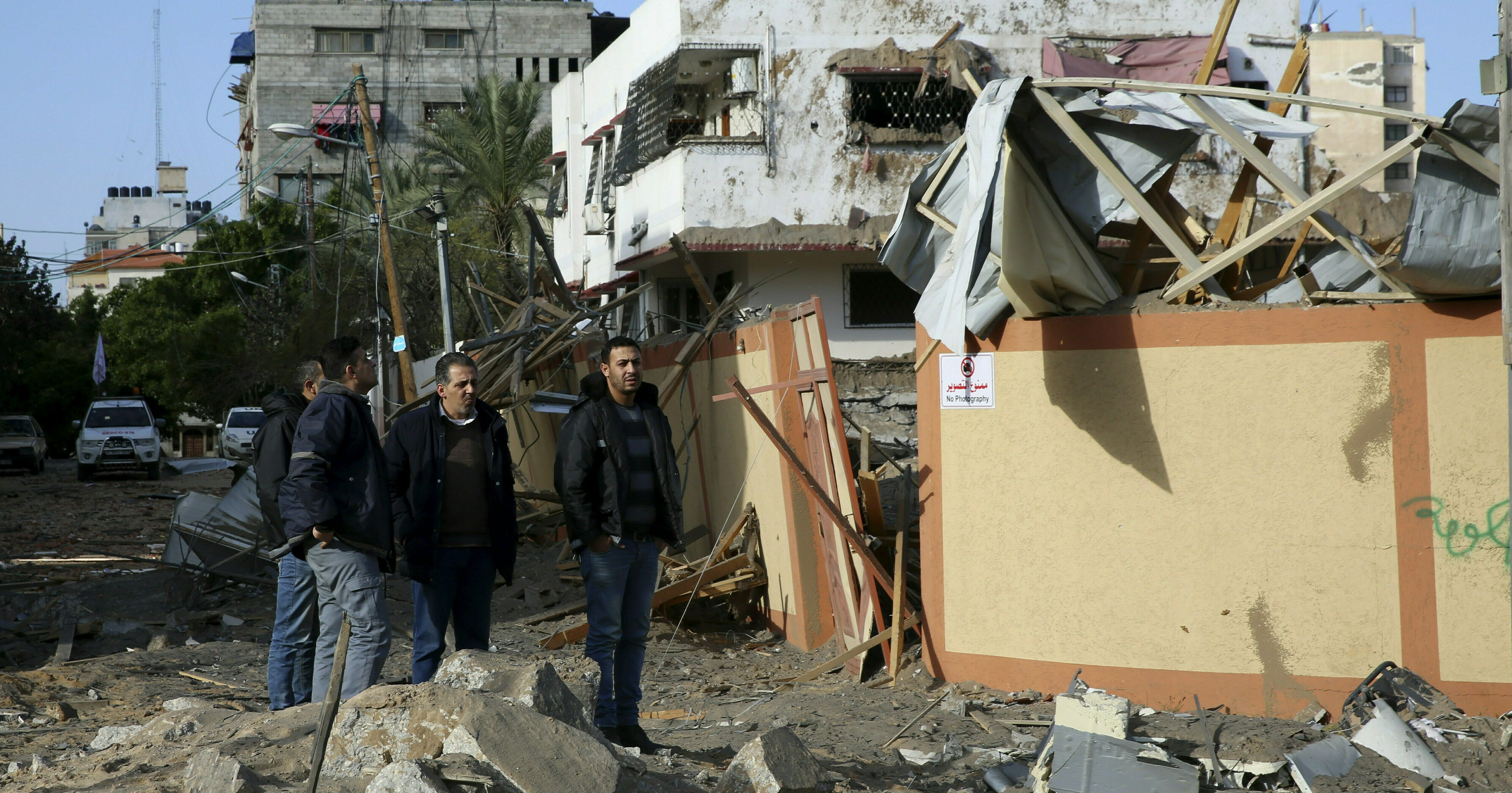 Palestinians inspect the damage of the offices of Hamas leader Ismail Haniyeh, in Gaza City, Tuesday, March 26, 2019.