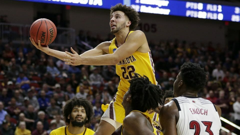 Minnesota's Gabe Kalscheur goes for a layup as Louisville's Steven Enoch watches their first-round NCAA Tournament game March 21, 2019, in Des Moines, Iowa.