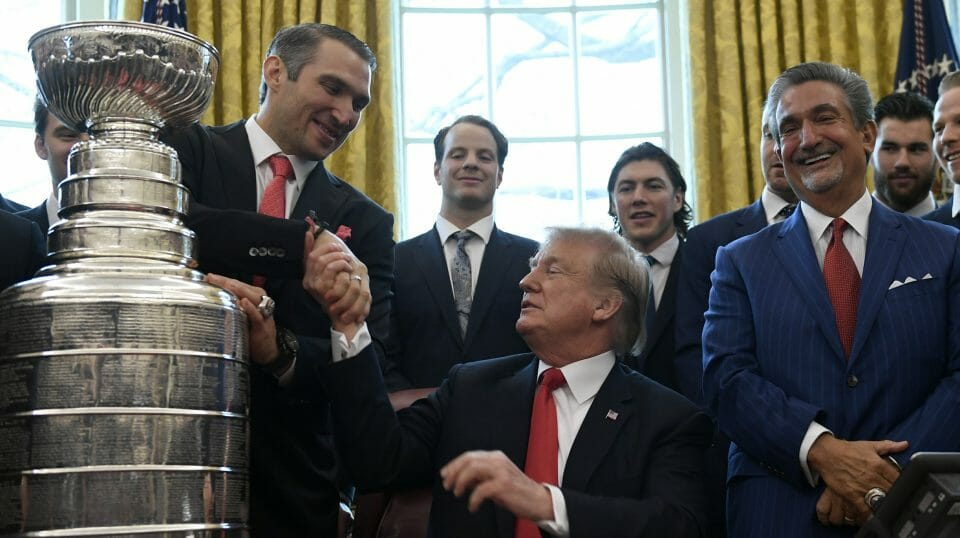 President Donald Trump, center, shakes hands with Alex Ovechkin, second from left, the captain and MVP of the 2018 Stanley Cup Champion Washington Capitals hockey team, during a visit to the Oval Office of the White House in Washington, Monday, March 25, 2019.
