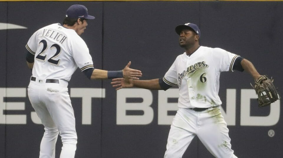 The Milwaukee Brewers' Lorenzo Cain, right, is congratulated by Christian Yelich