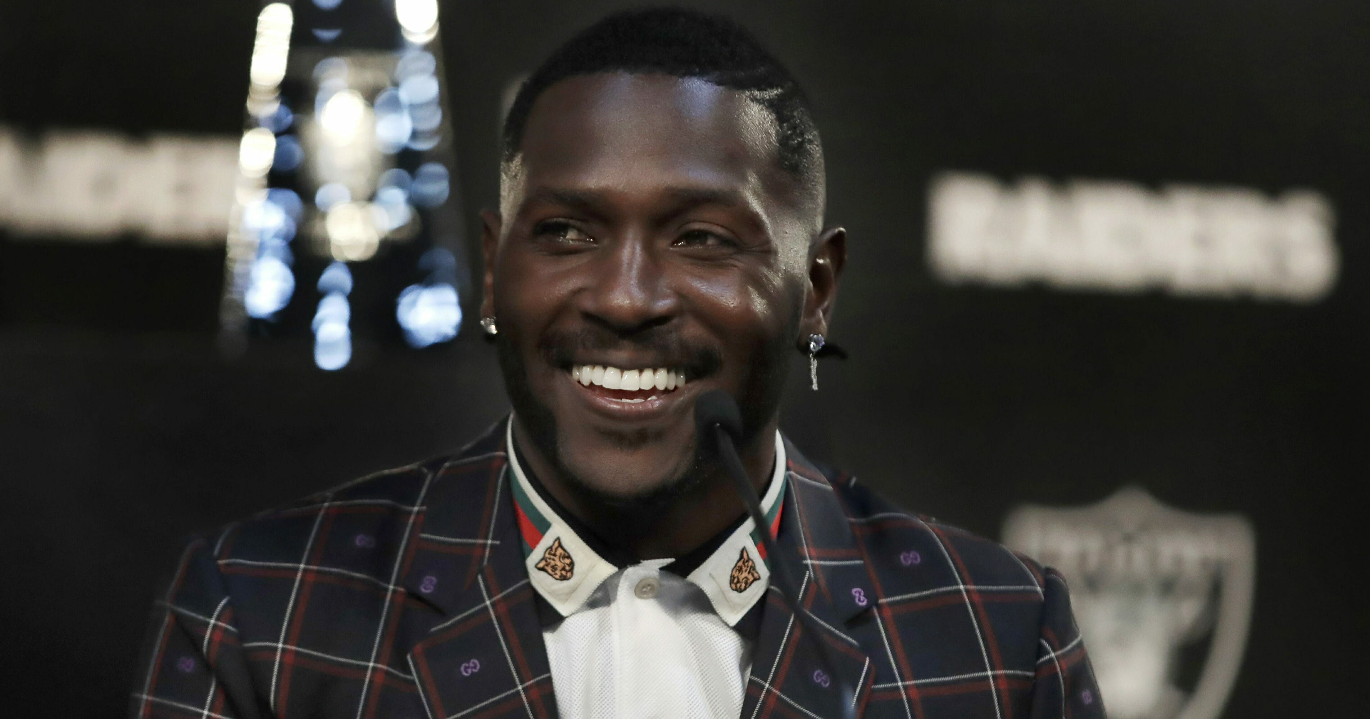 Oakland Raiders wide receiver Antonio Brown smiles during a news conference March 13, 2019, in Alameda, California.