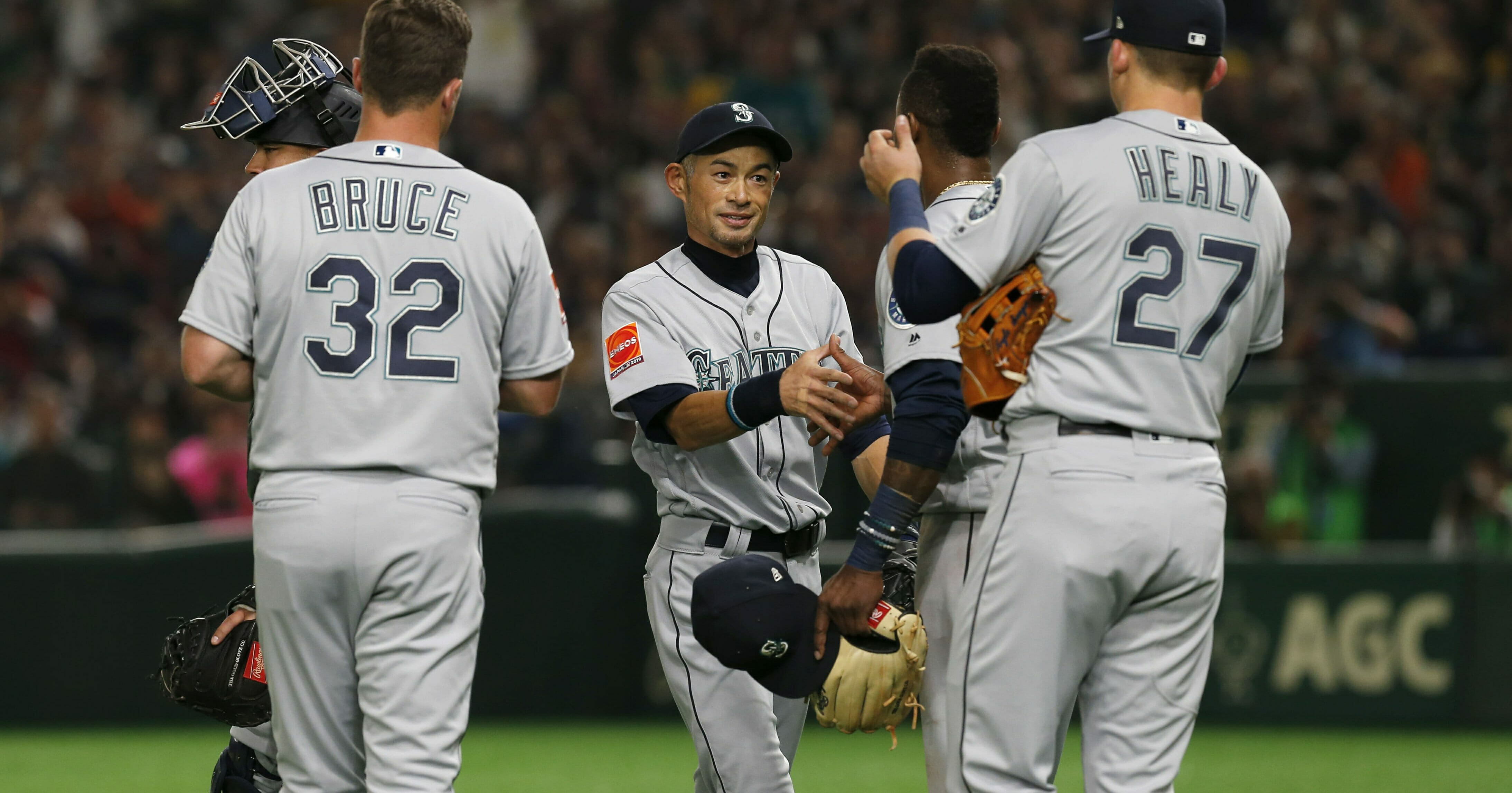 Seattle Mariners right fielder Ichiro Suzuki, center, talks to his teammates while leaving the field for defense substitution in the fourth inning of Game 1 of the Major League opening baseball series against the Oakland Athletics in Tokyo on, March 20, 2019.