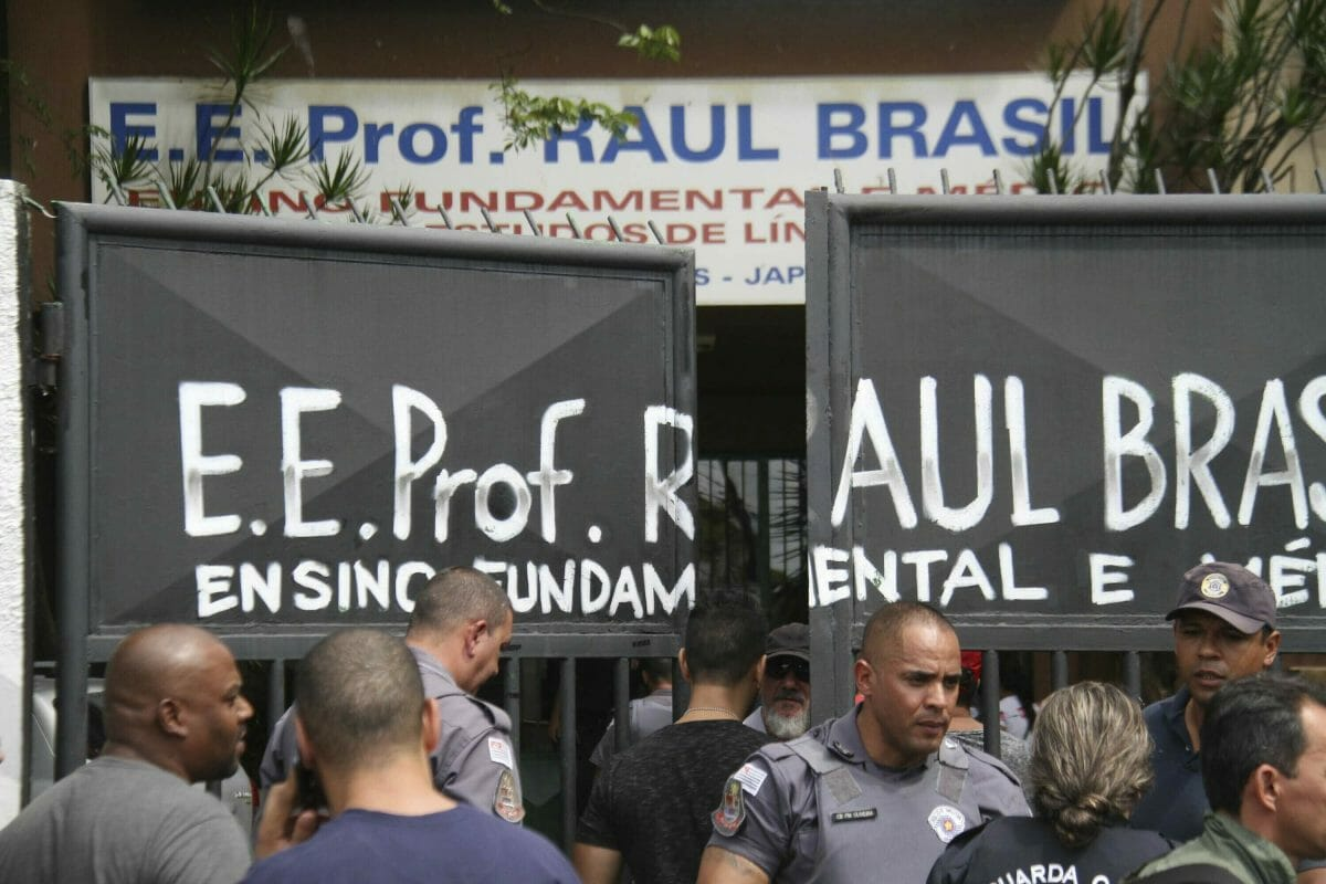Police officers guard the entrance of the Raul Brasil State School in Suzano, Brazil, on March 13, 2019.