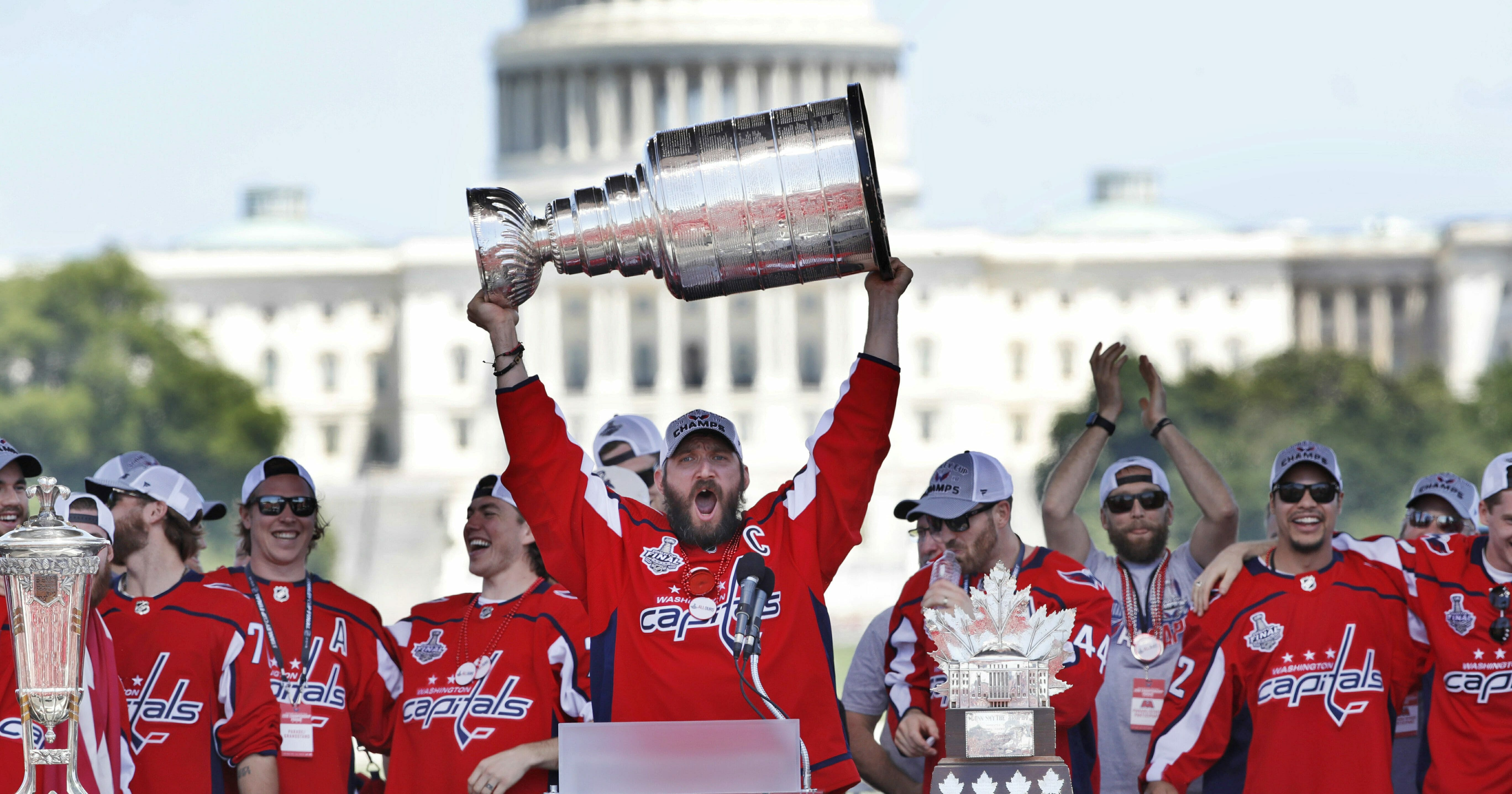 Washington Capitals star Alex Ovechkin holds up the Stanley Cup during the team's championship celebration at the National Mall in Washington on June 12, 2018.