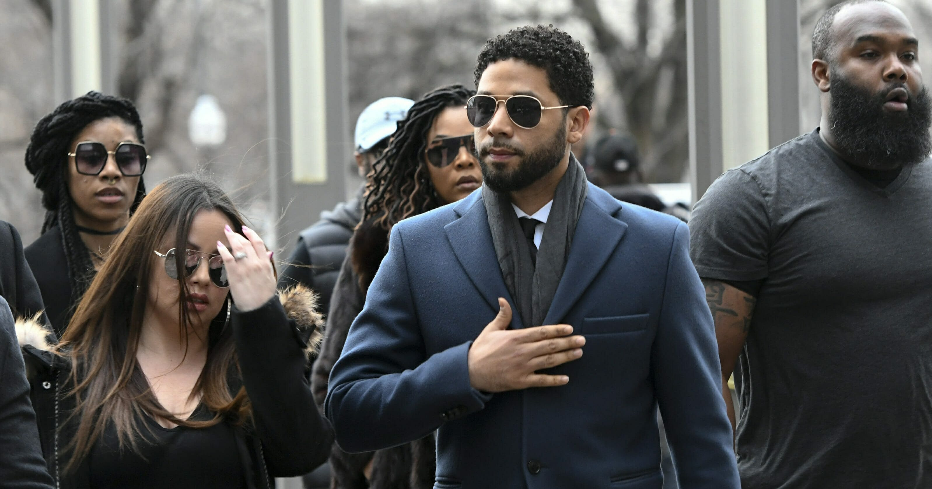 """""""Empire"""" actor Jussie Smollett, center, arrives at the Leighton Criminal Court Building in Chicago for a hearing March 14, 2019."""