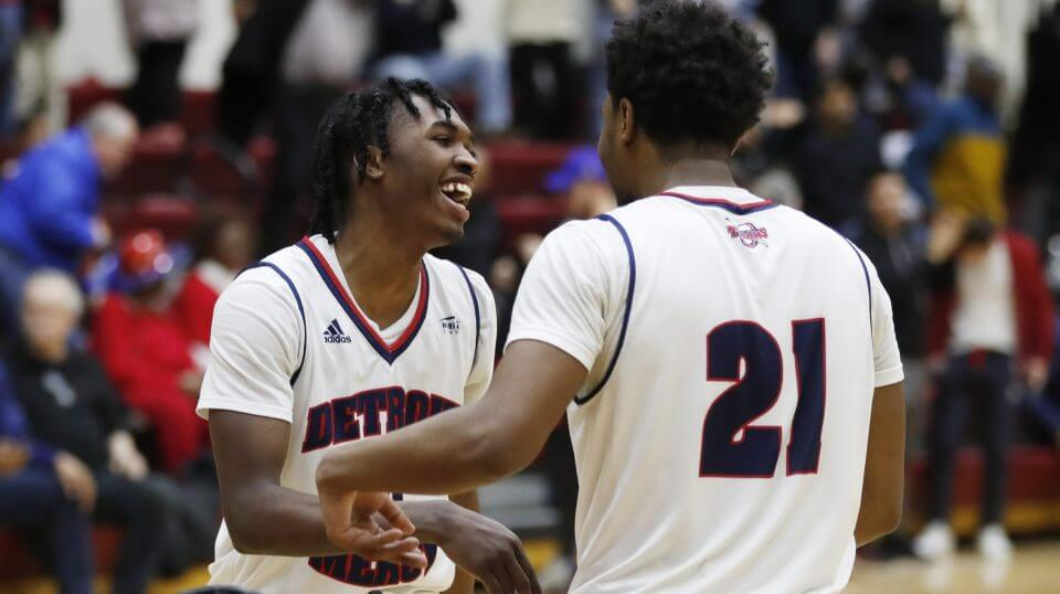 Detroit Mercy guards Antoine Davis, left, and Lamar Hamrick greet each other after the team's 87-85 win over IUPUI in an NCAA college basketball game, Thursday, Feb. 28, 2019, in Detroit.