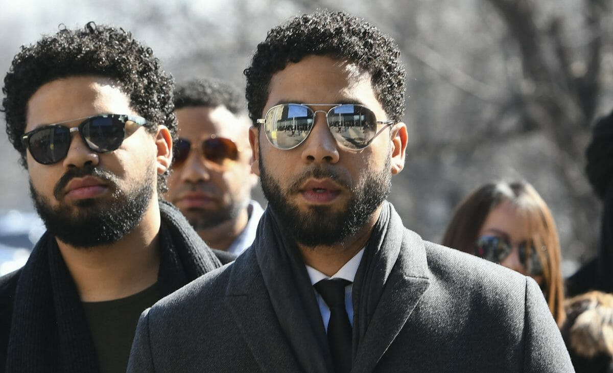 """""""Empire"""" actor Jussie Smollett, center, arrives at Leighton Criminal Court Building for a hearing to discuss whether cameras will be allowed in the courtroom during his disorderly conduct case on Tuesday, March 12, 2019, in Chicago."""
