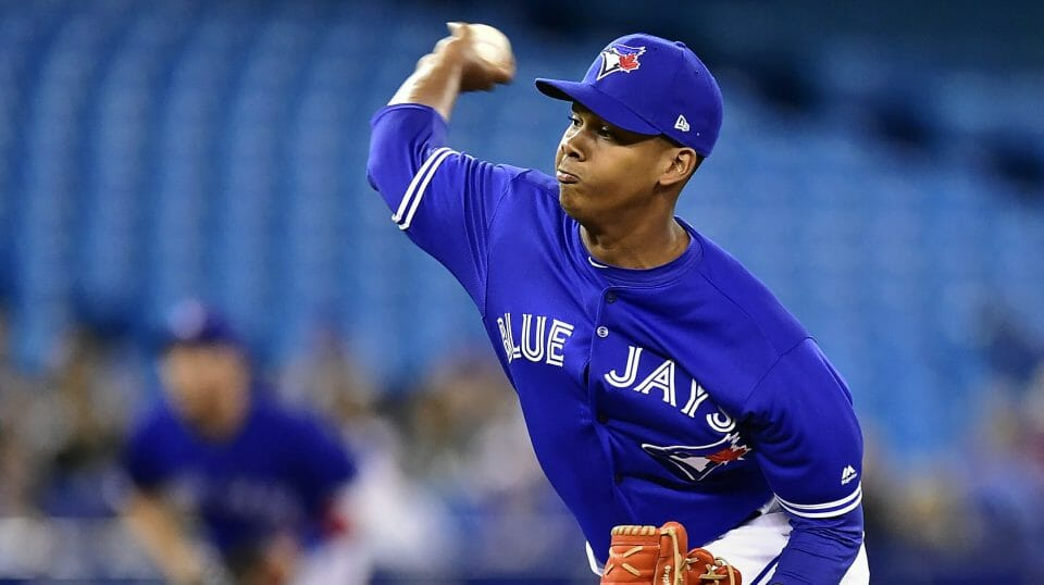 Toronto Blue Jays relief pitcher Elvis Luciano (65) works against the Detroit Tigers during the seventh inning of a baseball game in Toronto on Sunday, March 31, 2019.