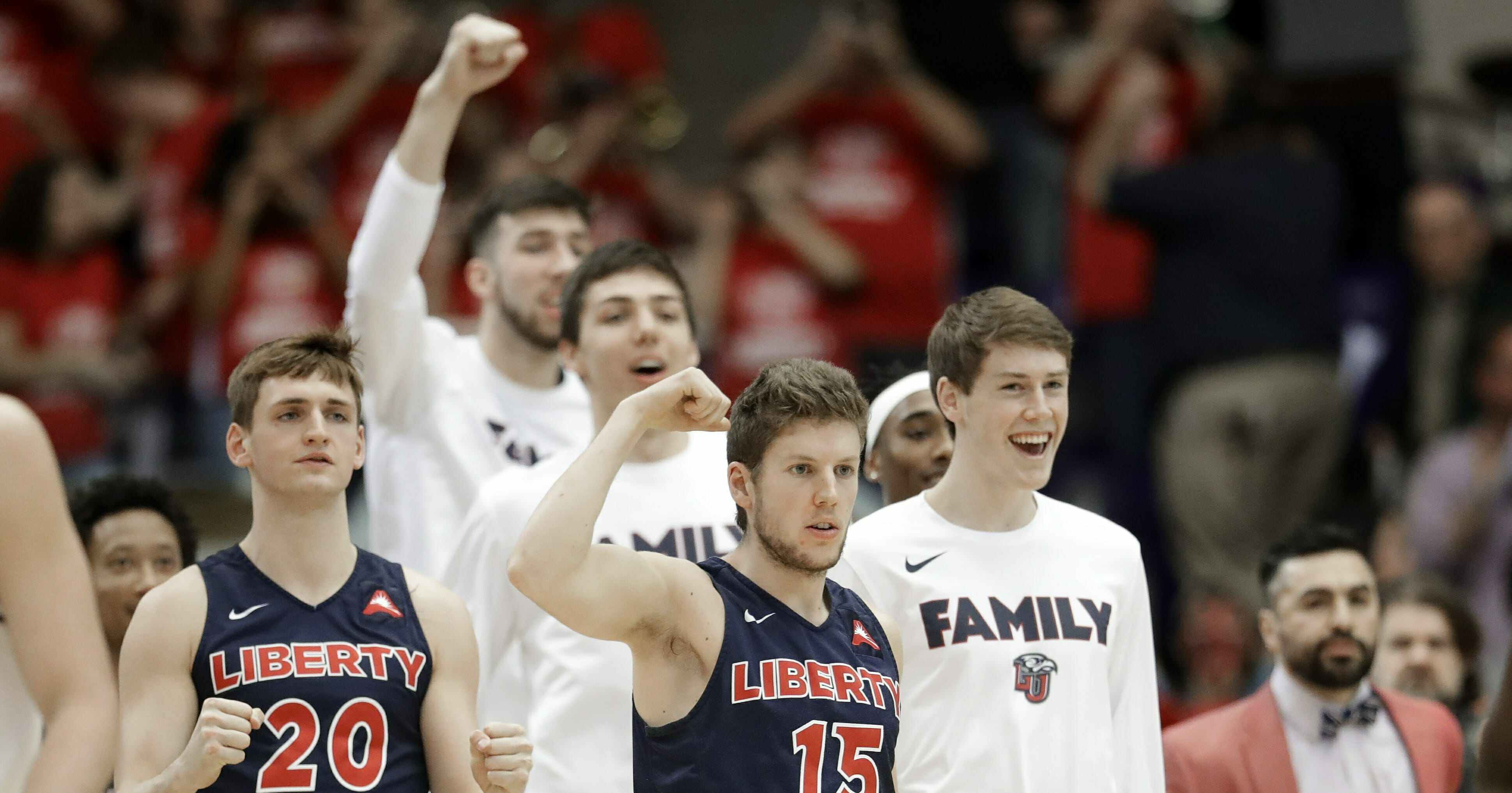 Liberty's Keegan McDowell and Zach Farquhar celebrate a score against Lipscomb in the first half of the Atlantic Sun NCAA college basketball tournament championship game Sunday, Mar. 10, 2019, in Nashville, Tenn.