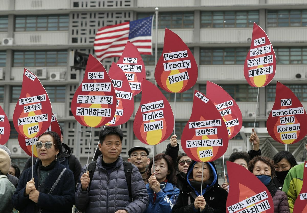 Protesters hold signs during a rally demanding the denuclearization of the Korean Peninsula and peace treaty near the U.S. embassy in Seoul, South Korea.