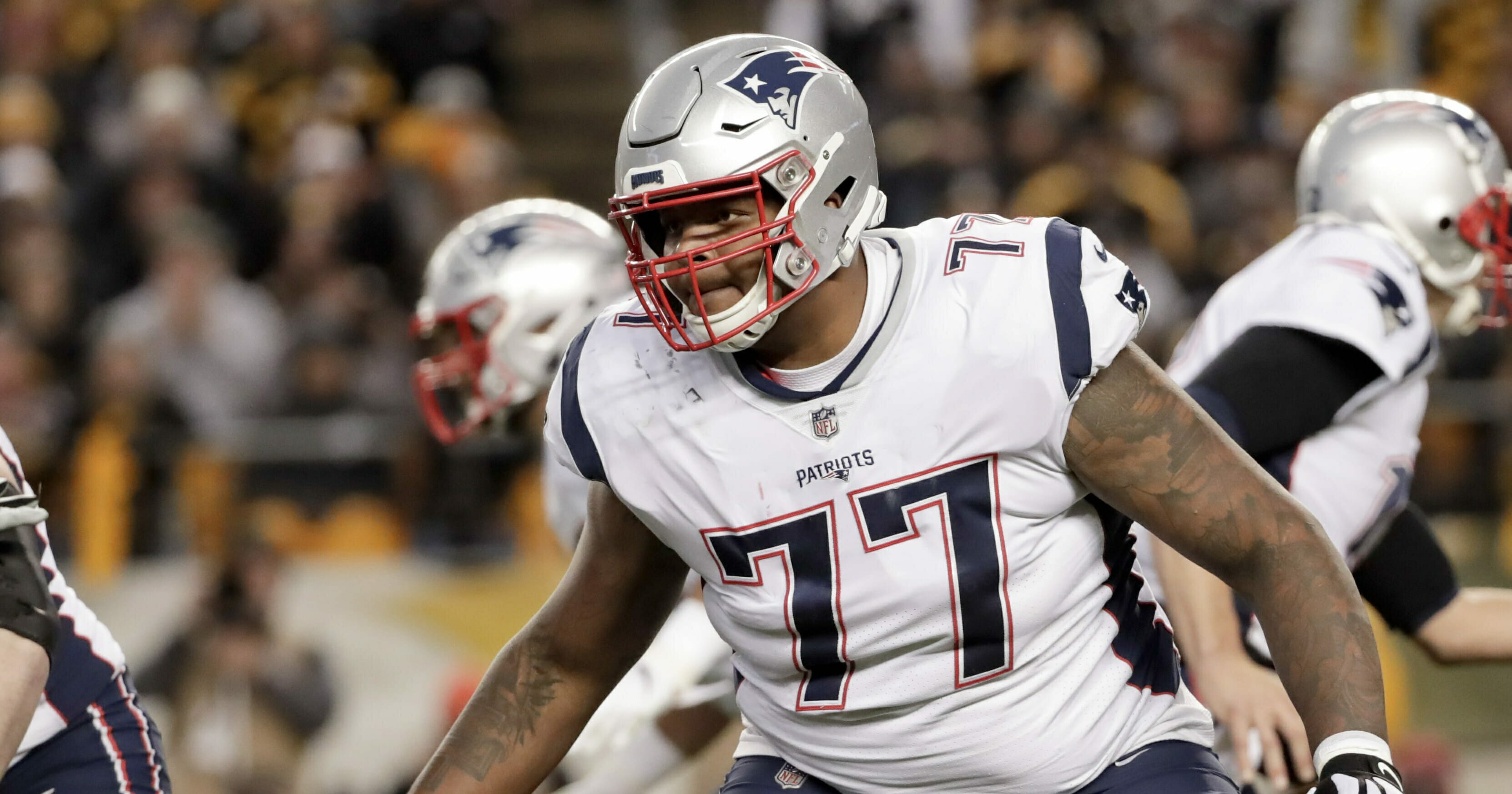 In this Dec. 16, 2018, file photo, New England Patriots offensive tackle Trent Brown plays against the Pittsburgh Steelers in an NFL football game, in Pittsburgh.