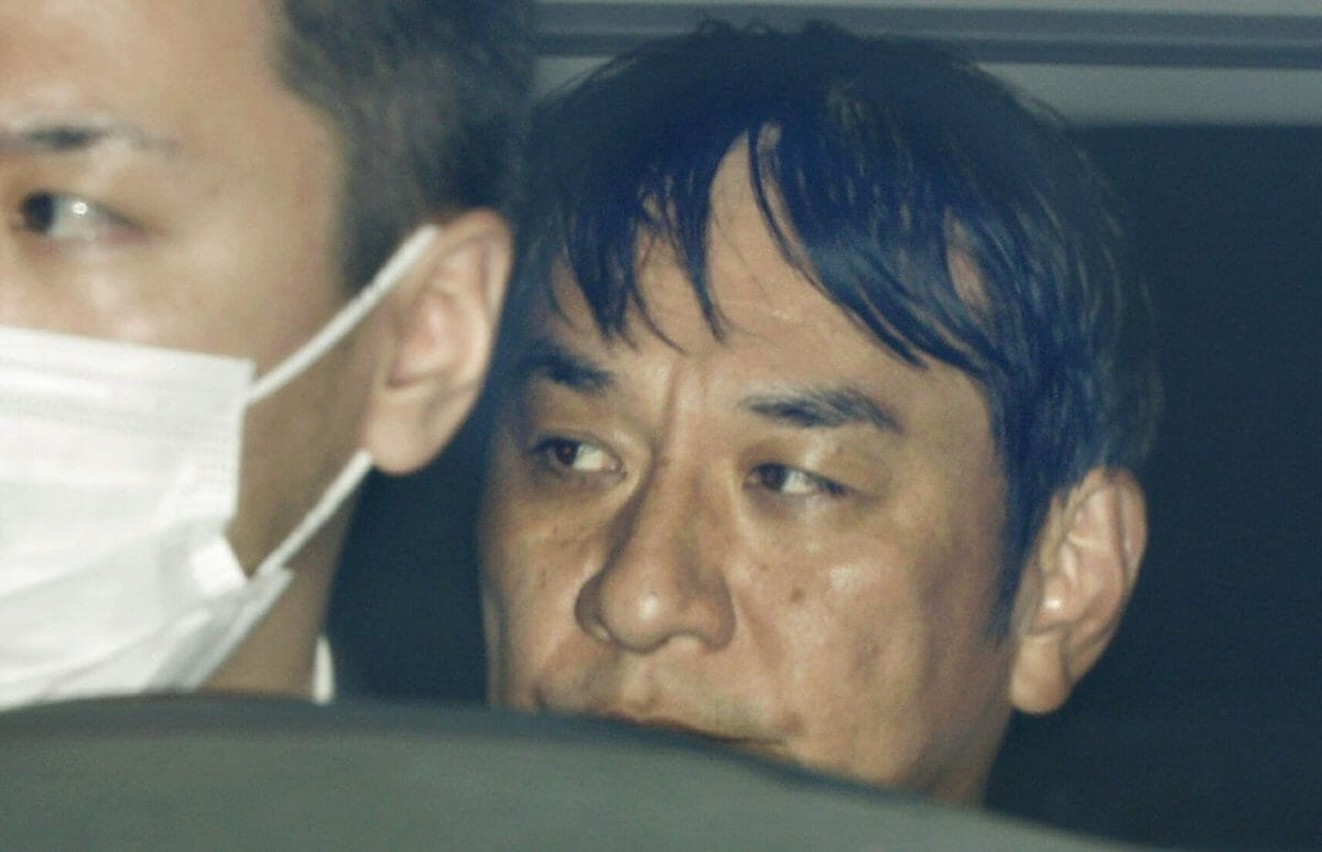 In this March 14, 2019, photo, Japanese musician Pierre Taki in a police car is sent to a prosecutor's office in Tokyo.