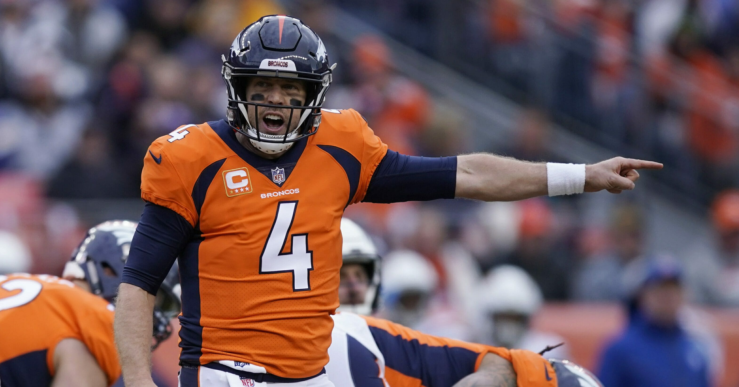 In this Dec. 30, 2018, file photo, Denver Broncos quarterback Case Keenum calls out to teammates during the first half of the team's NFL football game against the Los Angeles Chargers in Denver.