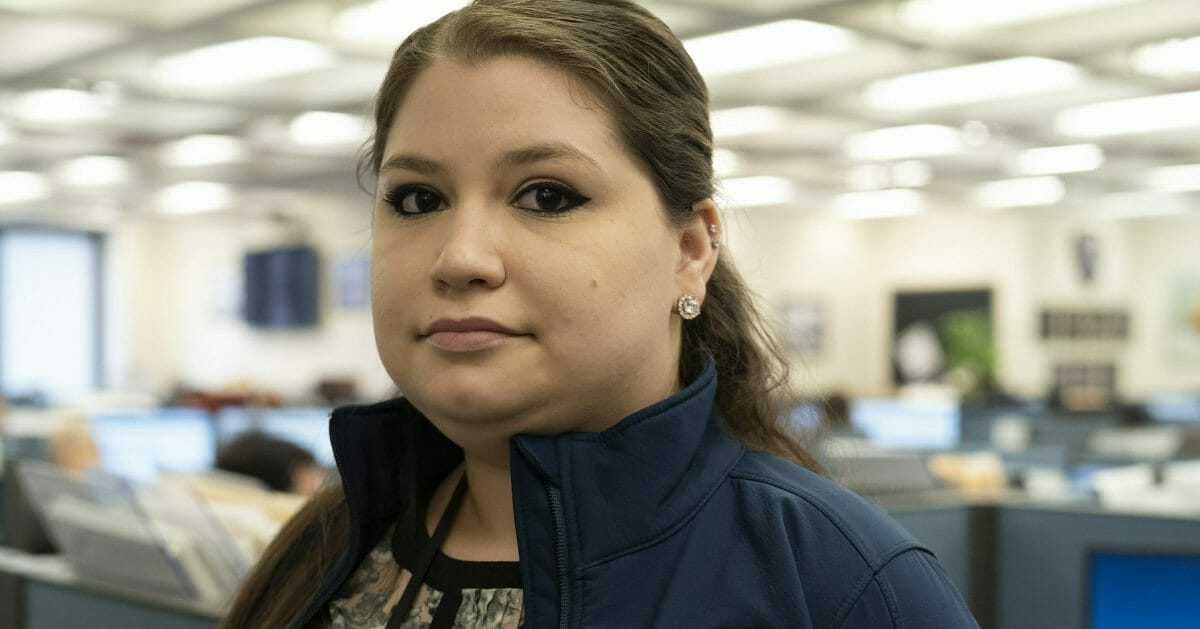 Rebecca Shutt, who works in the New York Police Department's Office of Crime Control Strategies, poses for a photo in New York on Feb. 11, 2019. Shutt utilizes a software called Patternizr, which allows crime analysts to compare robbery, larceny and theft incidents to the millions of crimes logged in the NYPD's database, aiding their hunt for crime patterns. It's much faster than the old method, which involved analysts sifting through reports and racking their brains for similar incidents.