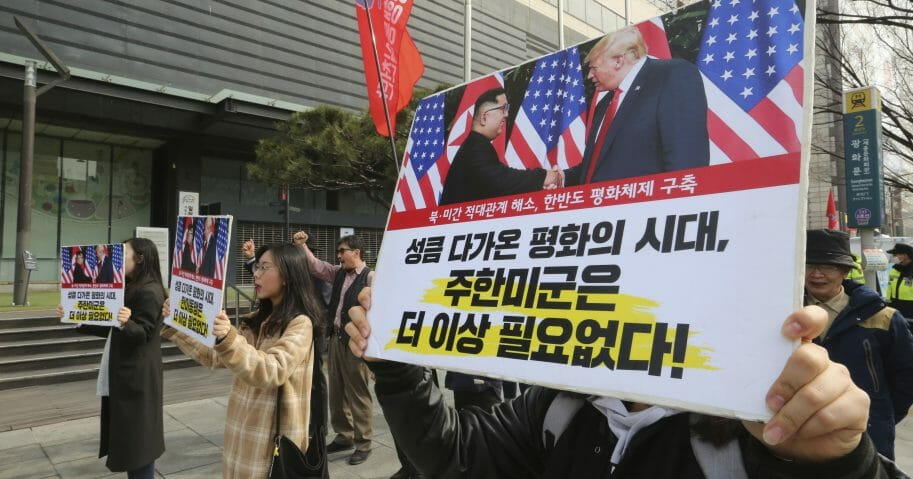 South Korean protesters with banners showing photos of U.S. President Donald Trump and North Korean leader Kim Jong Un stage a rally to denounce policies of the United States on North Korea in Seoul, South Korea.