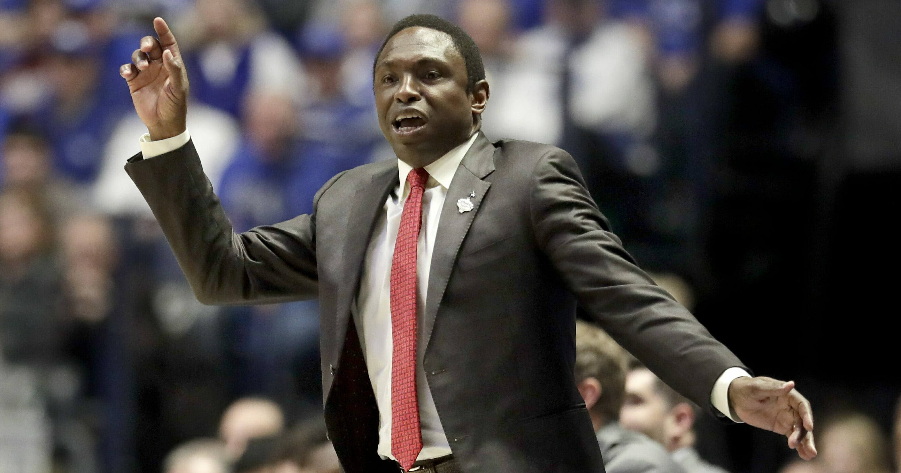 Alabama head coach Avery Johnson watches the action in the first half of an NCAA college basketball game against Kentucky at the Southeastern Conference tournament Friday, Mar. 15, 2019, in Nashville.