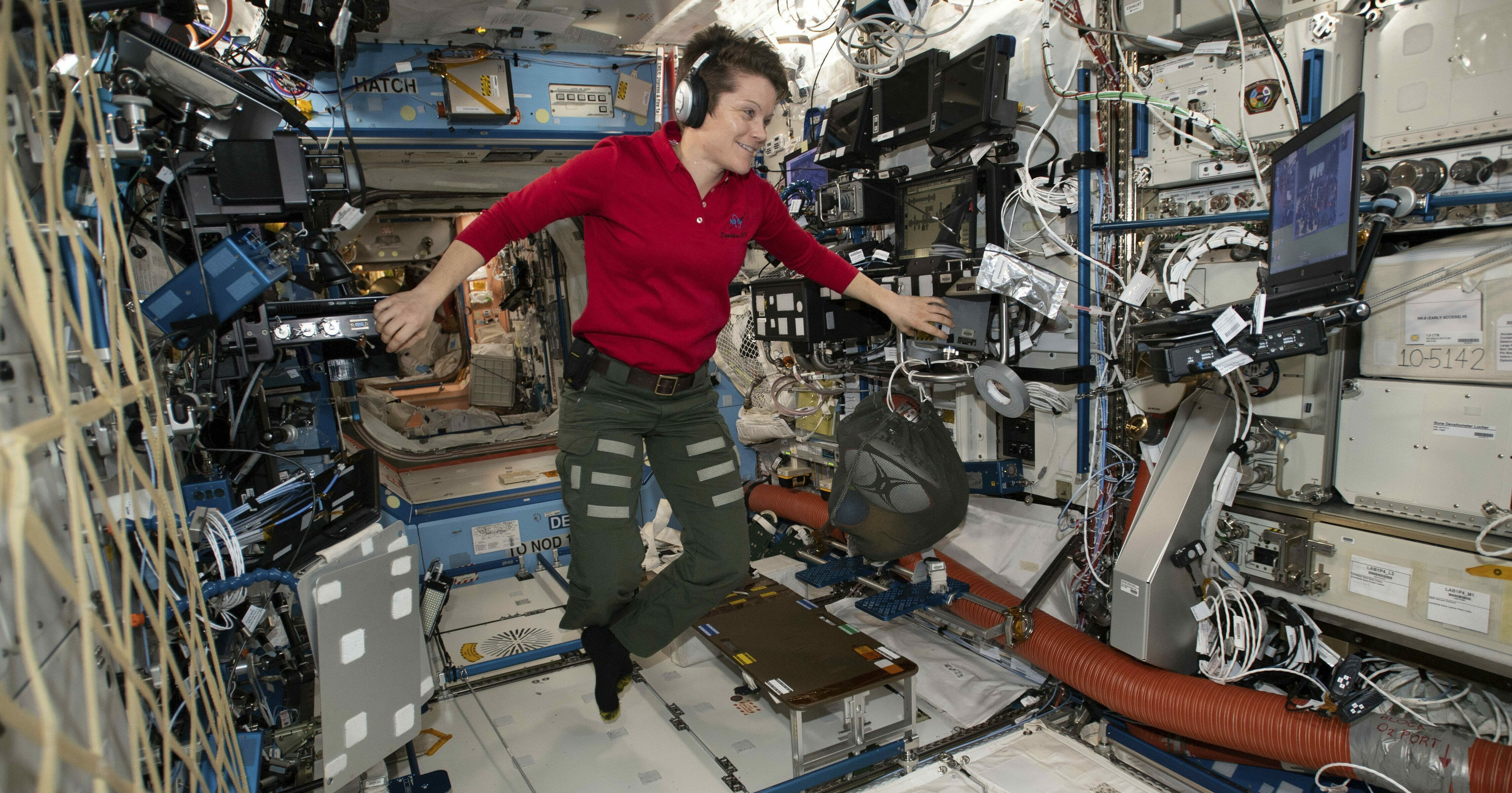 Flight Engineer Anne McClain looks at a laptop computer screen inside the U.S. Destiny laboratory module of the International Space Station on Jan. 18, 2019.