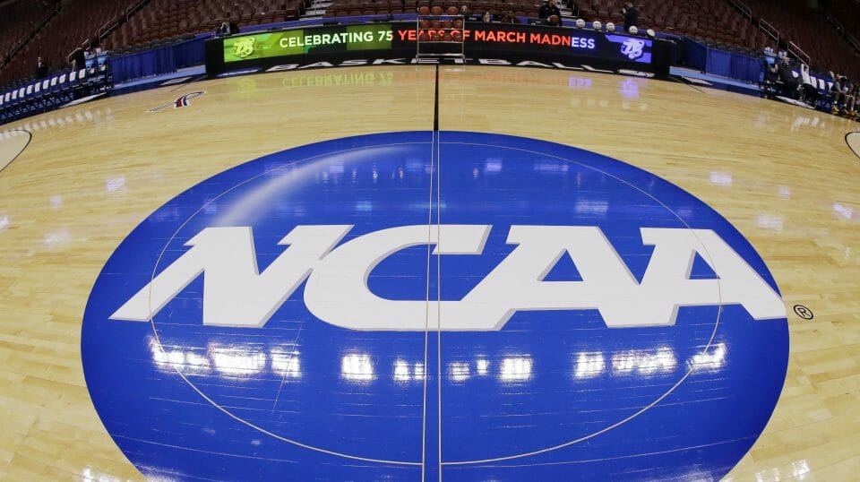 In a March 21, 2013, photo taken with a fisheye lens, the NCAA logo is displayed at midcourt before Albany's practice for a second-round NCAA tournament game in Philadelphia.
