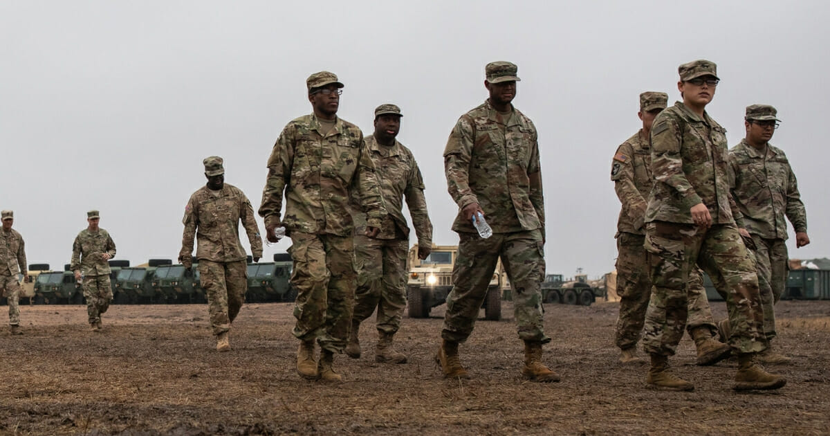 U.S. Army soldiers deployed to the U.S.-Mexico border walked toward a mess tent on November 22, 2018, in Donna, Texas.