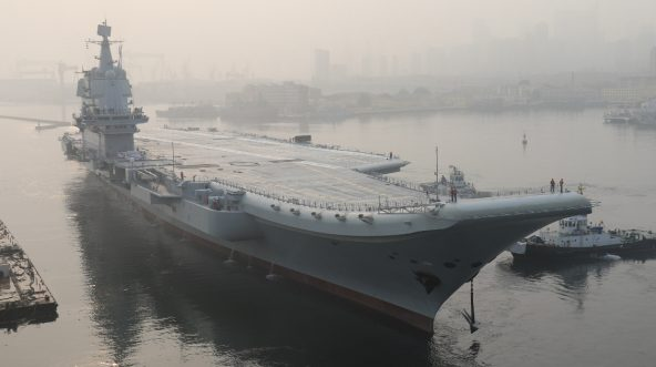China's first domestically manufactured aircraft carrier, known only as Type 001A, leaves port in the city of Dalian early on May 13, 2018.