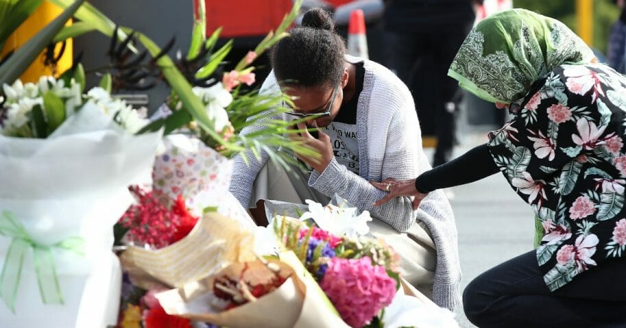 Locals lay flowers in tribute to those killed and injured at Deans Avenue near the Al Noor Mosque on March 16, 2019 in Christchurch, New Zealand.