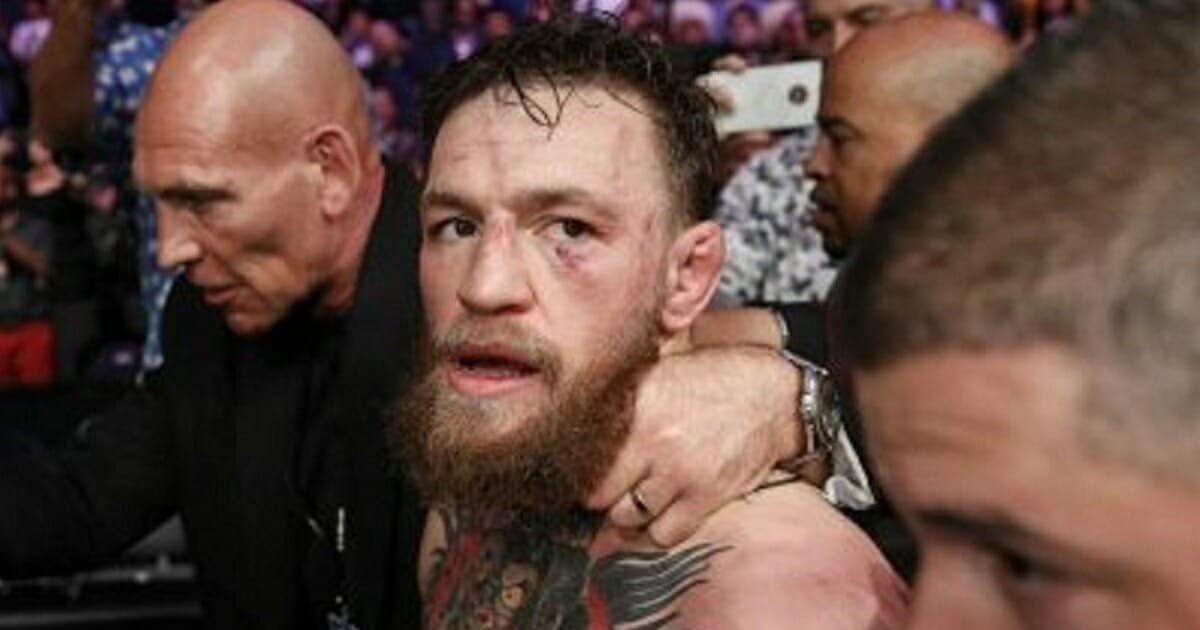 UFC superstar Conor McGregor walks out of the arena in October after he was defeated by Khabib Nurmagomedov in a lightweight title mixed martial arts bout at UFC 229 in Las Vegas.