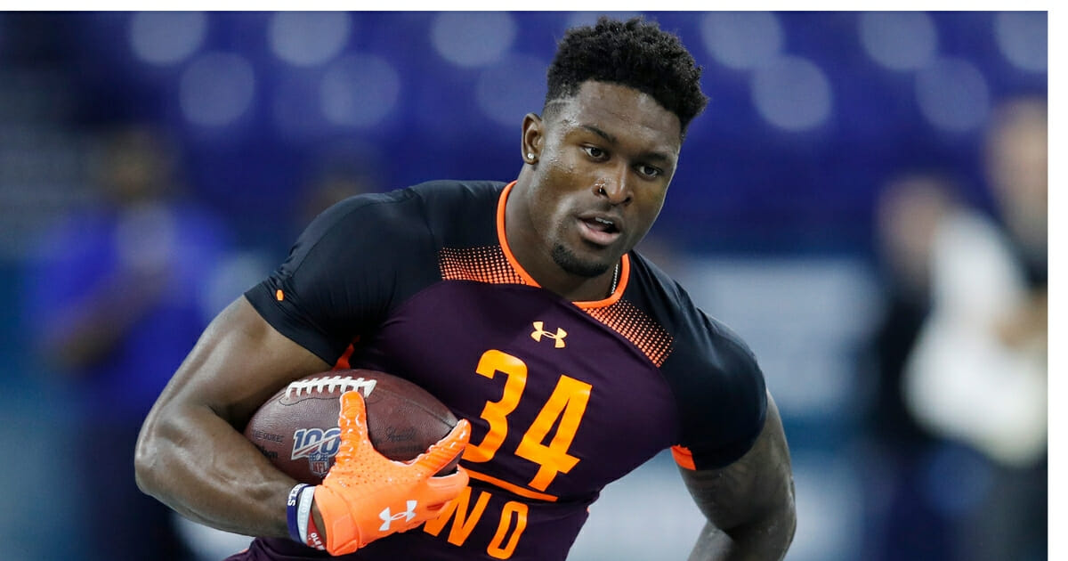 Wide receiver D.K. Metcalf of Ole Miss works out during the NFL Scouting Combine at Lucas Oil Stadium on March 2, 2019, in Indianapolis, Indiana.