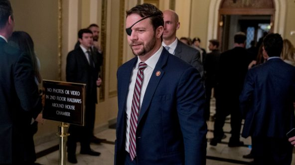 Rep. Dan Crenshaw, R-Texas, walks through the halls on Capitol Hill in Washington, Wednesday, Jan. 16, 2019.