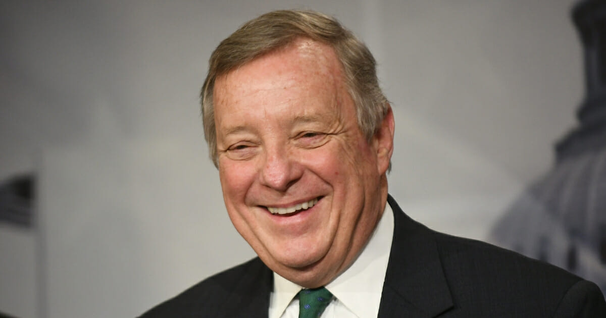 Sen. Dick Durbin laughs during a news conference March 12, 2019, in Washington, D.C.
