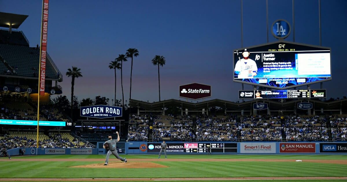 Robbie Ray #38 of the Arizona Diamondbacks pitches against the Los Angeles Dodgers in the first inning at Dodger Stadium on March 29, 2019 in Los Angeles.