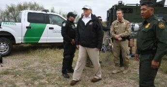 President Donald Trump stands with Border Patrol agents during a January trip to the U.S.-Mexico border.