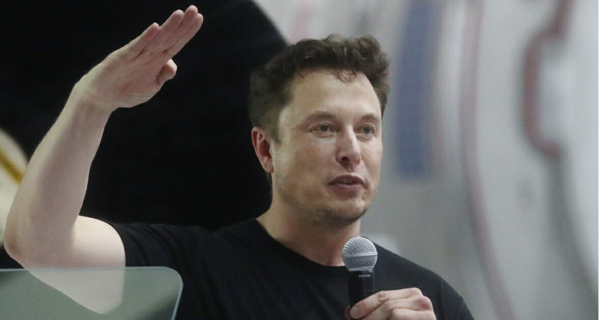 Elon Musk speaks at a news conference at SpaceX headquarters on Sept. 17, 2018, in Hawthorne, Calif.