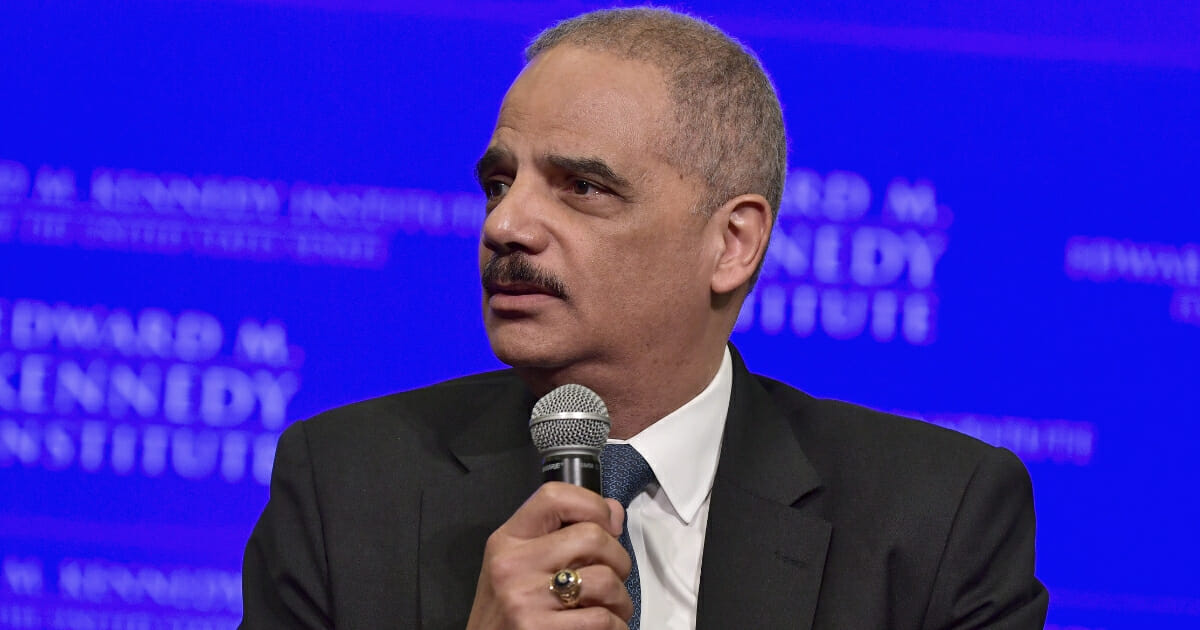 Former United States Attorney General Eric Holder is interviewed by Jeffrey Toobin for a discussion on gerrymandering and its impact on the American political system at the Edward M. Kennedy Institute for the United States Senate on May 30, 2018 in Boston, Massachusetts.