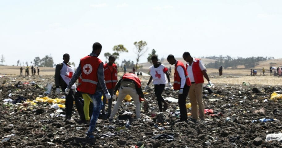 Red cross team work amid debris at the crash site of Ethiopia Airlines near Bishoftu, a town some 60 kilometres southeast of Addis Ababa, Ethiopia, on March 10, 2019. An Ethiopian Airlines Boeing 737 crashed on Sunday morning en route from Addis Ababa to Nairobi with 149 passengers and eight crew believed to be on board, Ethiopian Airlines said