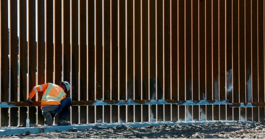 A construction worker builds a secondary wall along the U.S.-Mexico border in Otay Mesa, California, on Feb. 22, 2019