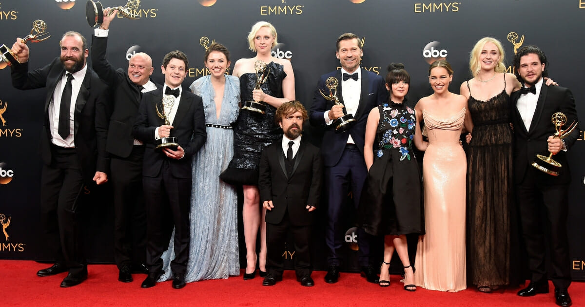 (Left-Right) Actors Rory McCann, Conleth Hill, Iwan Rheon, Gwendoline Christie, Peter Dinklage, Nikolaj Coster-Waldau, Maisie Williams, Emilia Clarke, Sophie Turner and Kit Harington, winners of Best Drama Series for 'Game of Thrones', pose in the press room during the 68th Annual Primetime Emmy Awards at Microsoft Theater on Sept. 18, 2016, in Los Angeles, California.