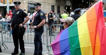 Police officer stand guard for the Gay Pride Parade in New York City in June.