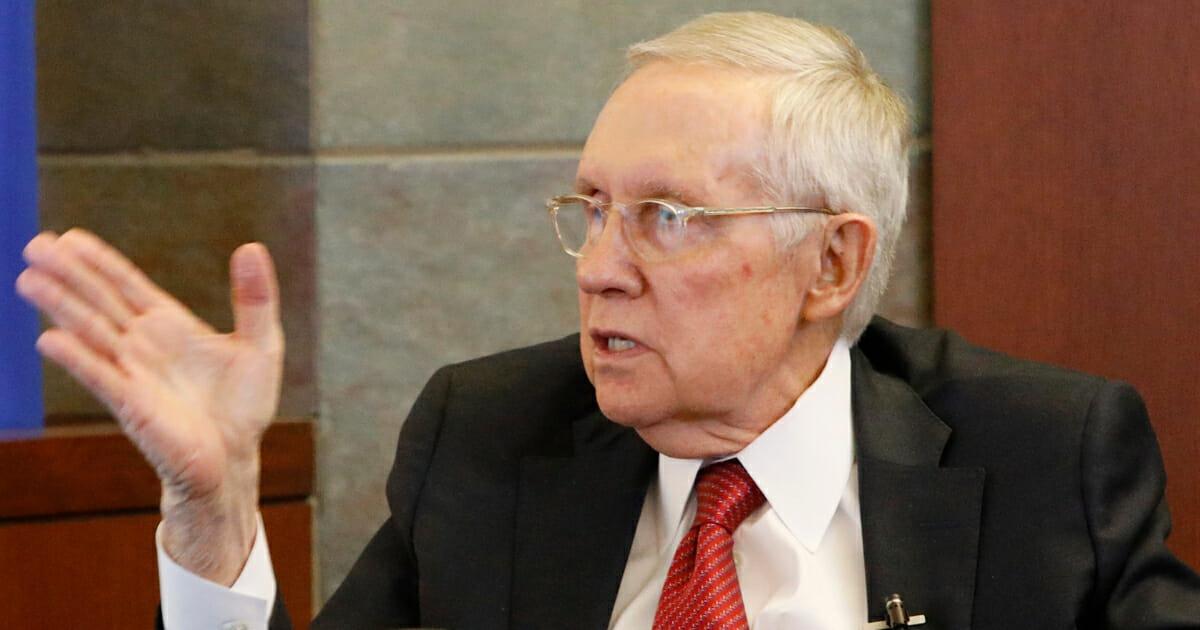 Former U.S. Sen. Harry Reid speaks from the witness stand Thursday, March 28, 2019, in Las Vegas.
