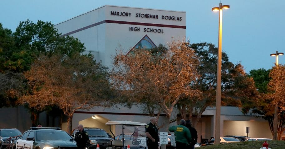 Law enforcement officers stand outside Marjory Stoneman Douglas High School on Feb. 14, the one-year anniversary of the mass shooting in Parkland, Florida.