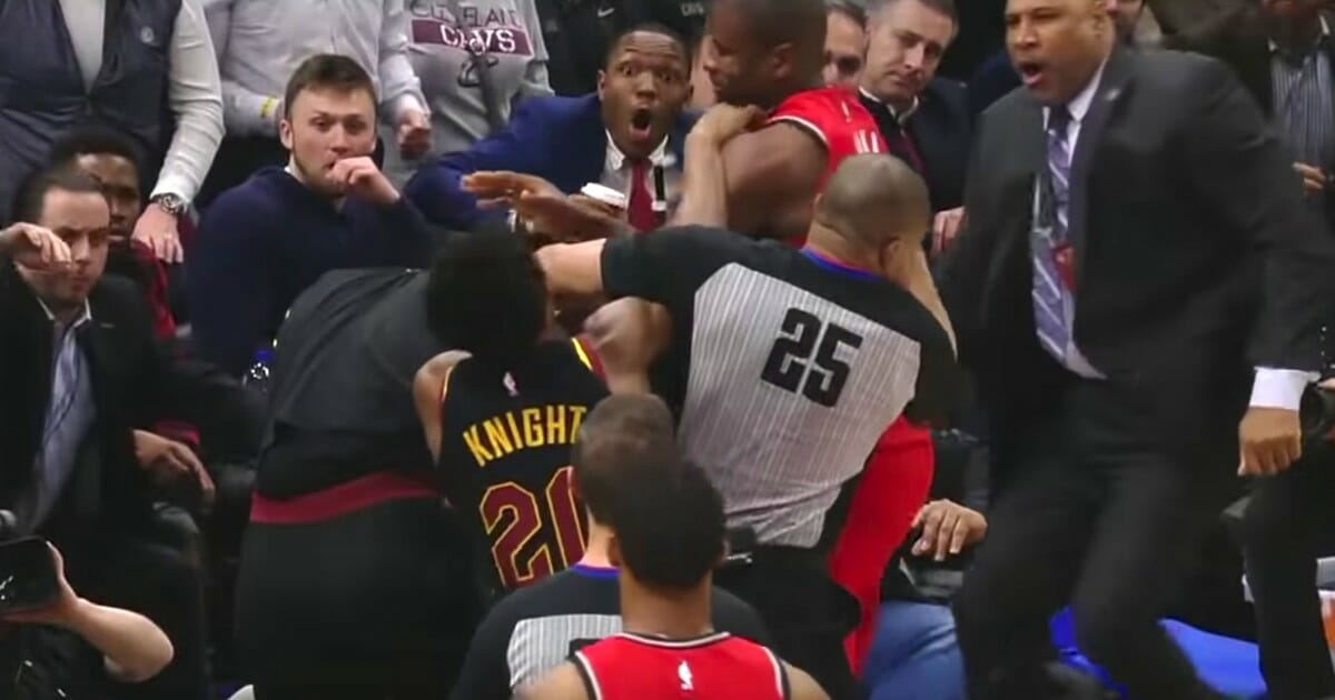 The Toronto Raptors' Serge Ibaka fights the Cleveland Cavaliers' Marquese Chriss after a long inbounds pass.